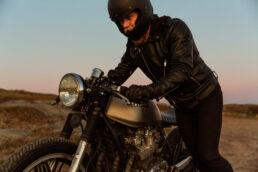 Café Racer Honda with man pushing motorcycle