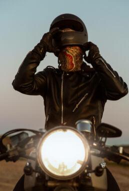 Motocycle driver put helmet on