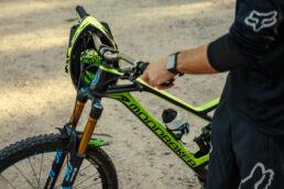 Monarker downhill bike with biker in sunset