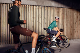 Two bikers in sunset with Tanline and pas normal studio clothing
