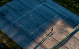 Tennis player in sunset shot with drone